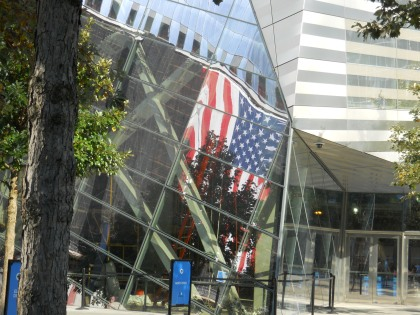 Flag reflecting in a building